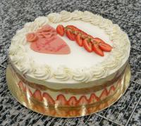 Réalisation d'un gâteau de mariage romantique et fleuri, à Marseille.